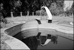 USA. Clovis, California. October, 2010. Swimming pool at a foreclosed house.