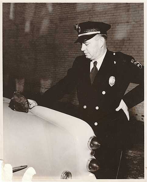 Police chief with meteorite, photographed by Harmon Mims, 1954